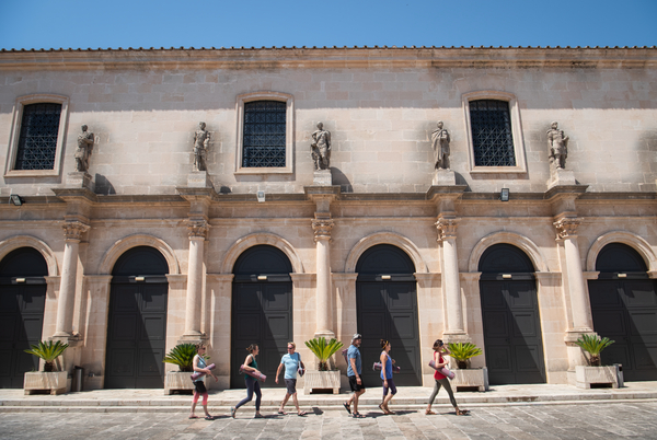 Group walking down the street in Mallorca