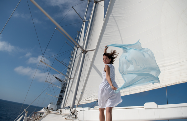 Women onboard Surf with Scarf in the Wind