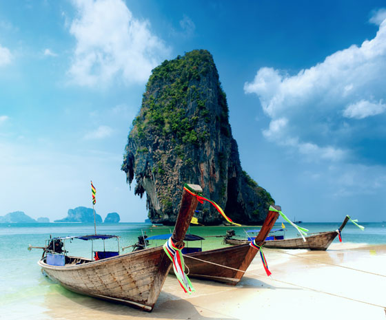 traditional asian boats on white beach